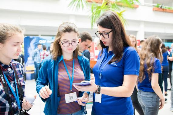 ASSIST Software employees talking with students at Codecamp Suceava event