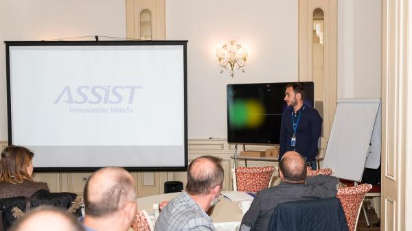 Adrian Onu - COO at ASSIST Software speaking in front of the audience from Connect Bucovina event